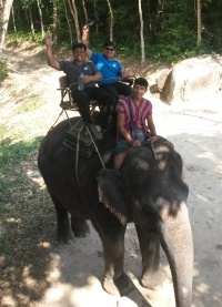 Lauro & Gil riding elephant